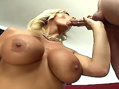 Blonde with nice juggs jumps on big cock