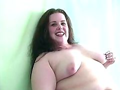 Portly brunette lady fucks on sofa
