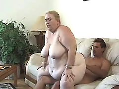 Flabby blonde grandma sucking cock