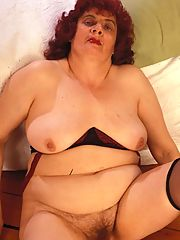Plump granny sperads and shows her big boobies