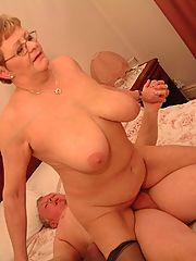 Busty granny Mandy kneading her plump tits while a hunk ate out her seasoned cunt and pounds it
