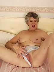 Granny spreads wide and shows her pink pussy