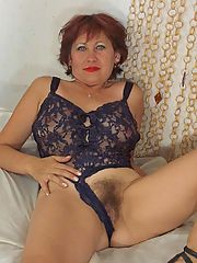 Horny redhead grandma stripping off her lace teddy to show her wet bush