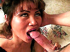 Asian granny mouth stuffed with cock