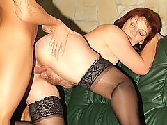 Older redhead Paula working a cock with her mouth and shows no problem in taking it in her coot